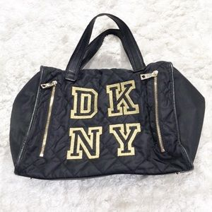 DKNY Black Quilted duffel bag with gold logo